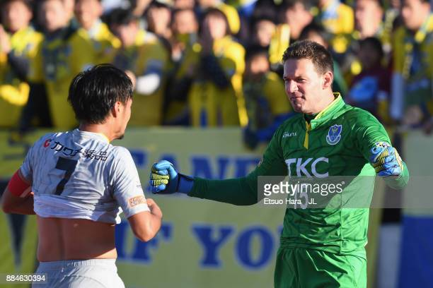Kazunori Kan and Johnny Leoni of Tochigi SC celebrate their 11 draw and the promotion to the J2 at the final whistle of the JLeague J3 match between...