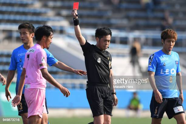 Kazunori Kan of Tochigi SC is shown a red card by referee Hirokazu Otsubo during the J.League J2 match between Yokohama FC and Tochigi SC at Nippatsu...