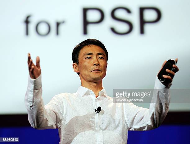 Kazunori Yamauchi game designer and of CEO of Polyphony Digital and creator and producer of the Gran Turismo video game series holds the new PSP Go...