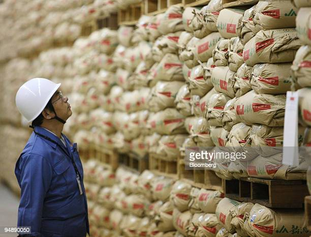 Kazuo Akaogi a coordinator for the disaster prevention facility at Japan's Ministry of Agriculture Forestry and Fisheries looks at sacks of...
