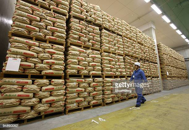 Kazuo Akaogi a coordinator for the disaster prevention facility at Japan's Ministry of Agriculture Forestry and Fisheries walks near sacks of...
