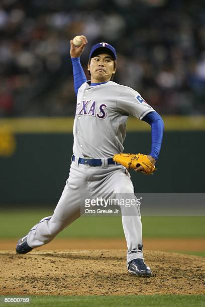 Kazuo Fukumori of the Texas Rangers pitches against the Seattle Mariners on March 31 2008 at Safeco Field in Seattle Washington