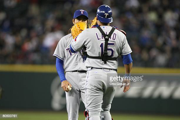 Kazuo Fukumori of the Texas Rangers speaks with Gerald Laird during the game against the Seattle Mariners on March 31 2008 at Safeco Field in Seattle...