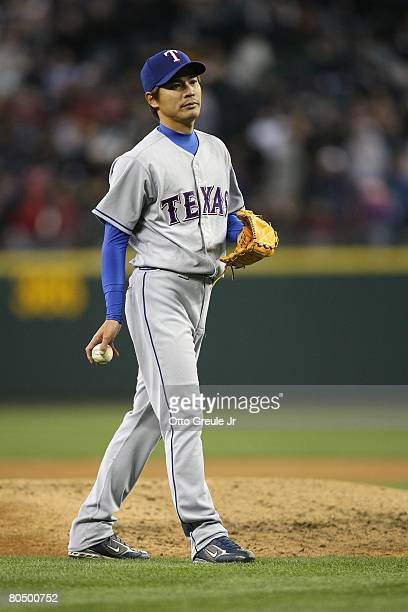 Kazuo Fukumori of the Texas Rangers stands on the field against the Seattle Mariners on March 31 2008 at Safeco Field in Seattle Washington