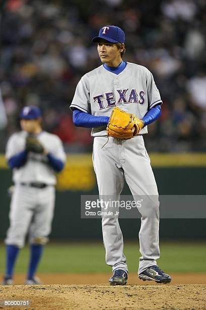 Kazuo Fukumori of the Texas Rangers stands on the mound against the Seattle Mariners on March 31 2008 at Safeco Field in Seattle Washington