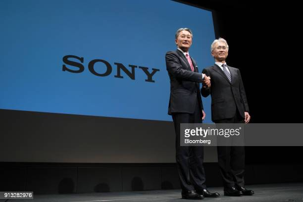 Kazuo Hirai incoming chairman of Sony Corp left and Kenichiro Yoshida incoming chief executive officer shake hands while posing for photographs...