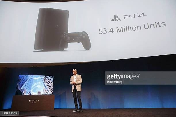 Kazuo Hirai president and chief executive officer of Sony Corp stands next to a Sony Sony XBRA1E Bravia OLED 4K HDR TV while speaking about the...