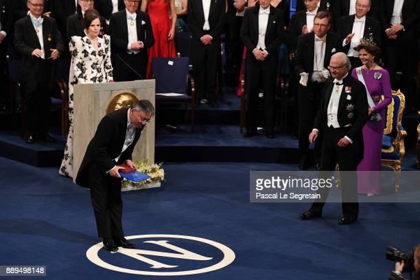 Kazuo Ishiguro laureate of the Nobel Prize in Literature aknowledges applause after he received his Nobel Prize from King Carl XVI Gustaf of Sweden...