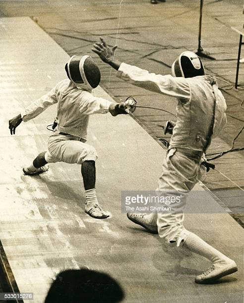 Kazuo Mano of Japan and Mohamed Gamil ElKalyoubi of the United Arab Republic compete in the Fencing Men's Individual Foil third round during the...