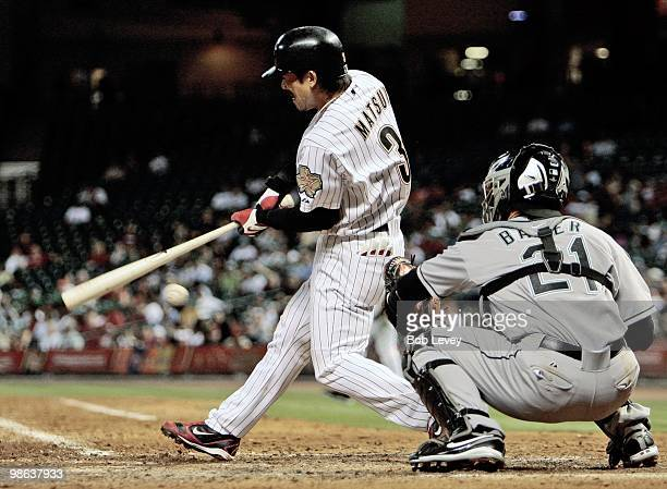 Kazuo Matsui of the Houston Astros fouls the ball off his knee against the Florida Marlins at Minute Maid Park on April 22 2010 in Houston Texas