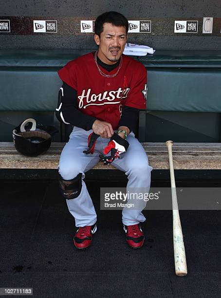 Kazuo Matsui of the Houston Astros gets ready in the dugout before the game between the Houston Astros and the San Francisco Giants on Saturday May...