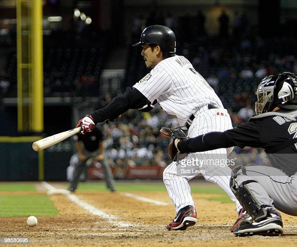 Kazuo Matsui of the Houston Astros lays down a sacrifice bunt in the eighth inning scoring Hunter Pence from third base at Minute Maid Park on April...