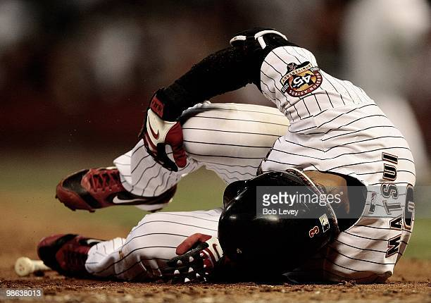 Kazuo Matsui of the Houston Astros lays on the ground after hitting a foul ball off his knee against the Florida Marlins at Minute Maid Park on April...