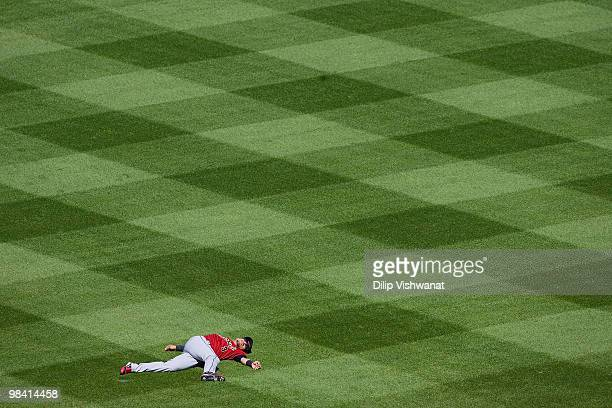 Kazuo Matsui of the Houston Astros stretches prior to playing against the St Louis Cardinals in the home opener at Busch Stadium on April 12 2010 in...