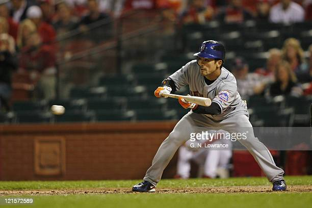 Kazuo Matsui of the Mets prepares to bunt during action between the New York Mets and the St Louis Cardinals at Busch Stadium in St Louis Missouri on...