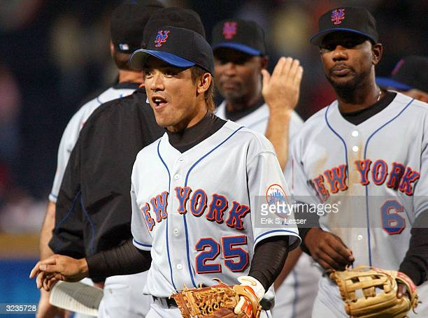 Kazuo Matsui of the New York Mets celebrates with teammates after his Major League debut against the Atlanta Braves at Turner Field on April 6 2004...