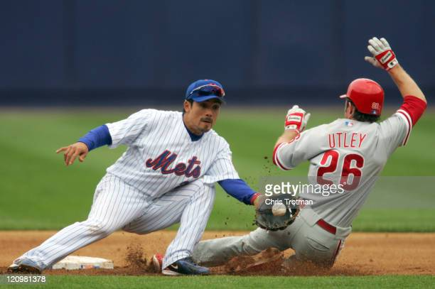 Kazuo Matsui of the New York Mets is unable to stop Chase Utley of the Philadelphia Phillies from stealing second base in the third inning at Shea...