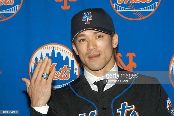 Kazuo Matsui wearing a Mets 1986 World Series ring