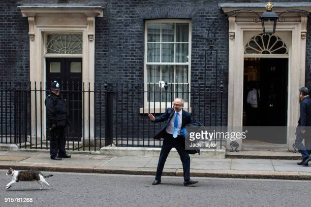 Kazuo Okamoto chief executive of Mitsubishi Heavy Industries Europe attempts to stroke Larry the Downing Street cat ahead of a meeting with British...