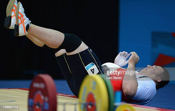 Kazuomi Ota of Japan reacts after failing to lift the weight during the Men's 105kg Weightlifting final on Day 11 of the London 2012 Olympic Games at...