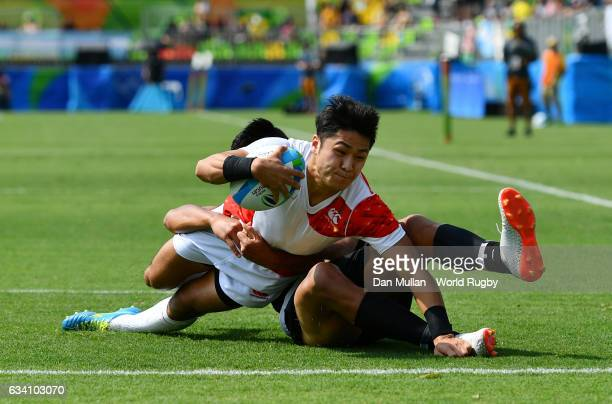 Kazushi Hano of Japan dives over for a try during the Men's Rugby Sevens Pool C match between New Zealand and Japan on Day 4 of the Rio 2016 Olympic...