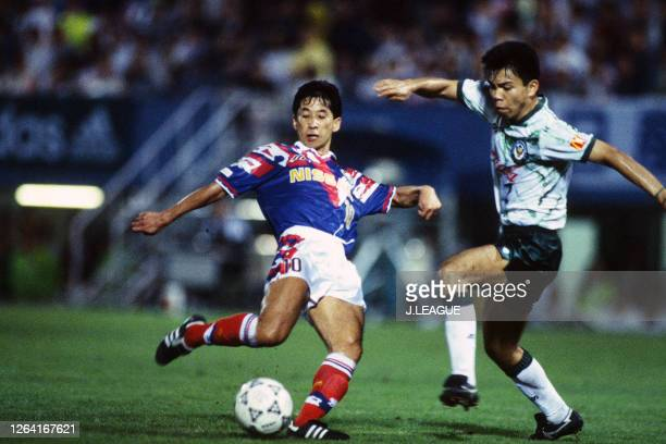 Kazushi Kimura of Yokohama Marinos and Tadashi Nakamura of Verdy Kawasaki compete for the ball during the JLeague Suntory Series match between...
