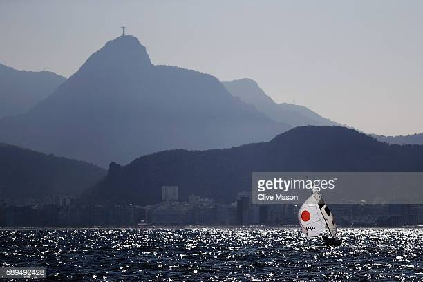 Kazuto Doi of Japan and Kimihiko Imamura of Japan compete in the shadow of Christ the Redeemer during the Men's 470 class on Day 9 of the Rio 2016...