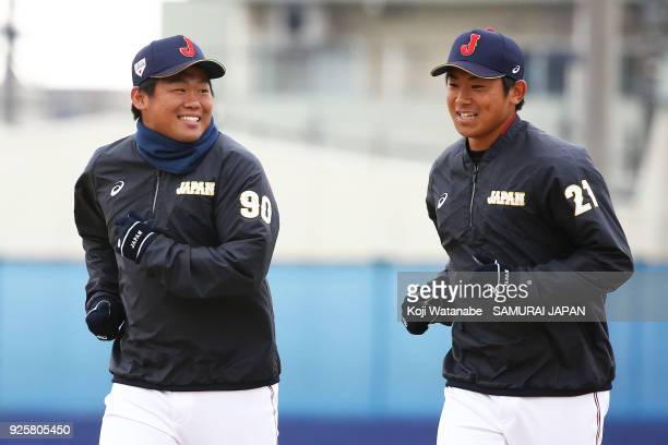 Kazuto Taguchi and Shota Imanaga in actin during a Japan training session at the Nagoya Dome on March 1 2018 in Nagoya Aichi Japan