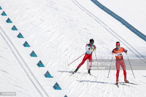 Kazuto Takamura of Japan and his guide Yuhei Fujita in the Men's 75 km Visually Impaired Biathlon competition at Alpensia Biathlon Centre on Day 1 of...