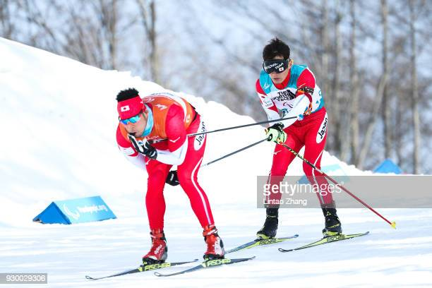 Kazuto Takamura of Japan and his guide Yuhei Fujita in the Men's 75km Visually Impaired Biathlon event at Alpensia Biathlon Centre during day one of...