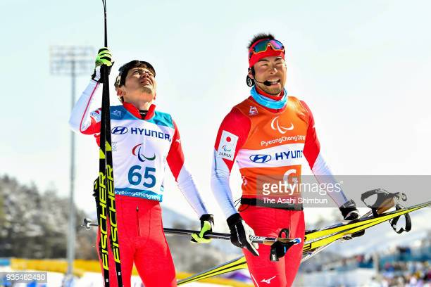 Kazuto Takamura of Japan and his guide Yuhei Fujita react after competing in the Cross Country Men's 10km Visually Impaired on Day eight of the...