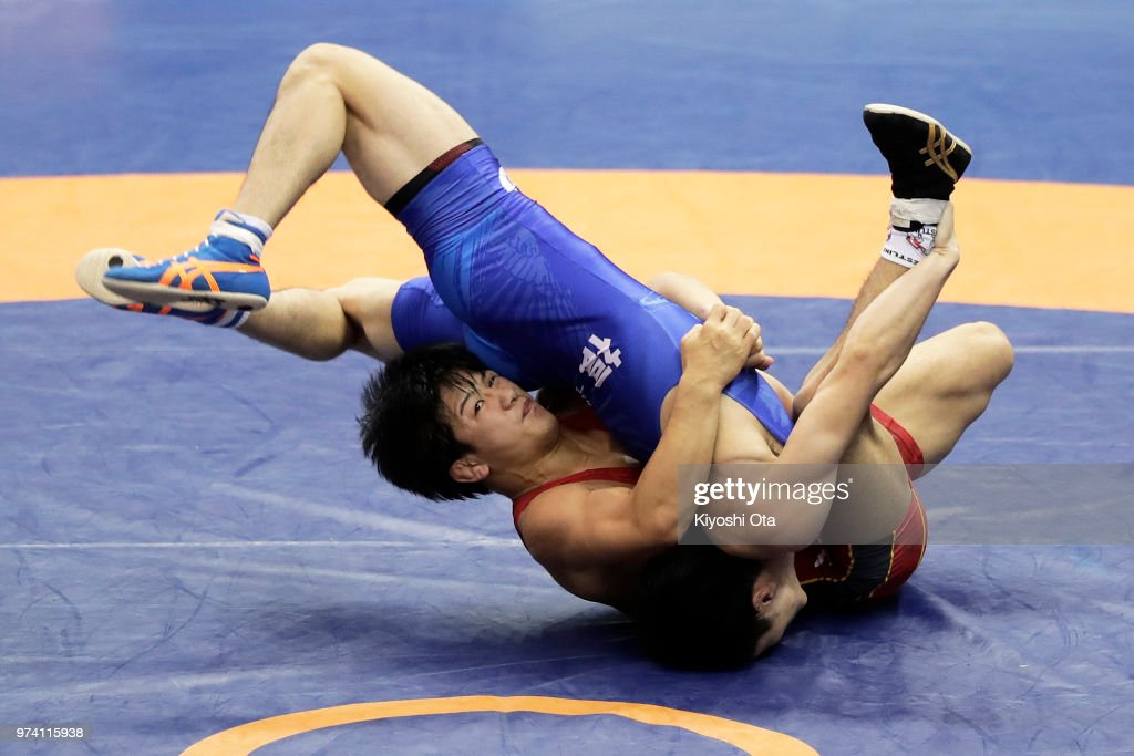 Kazuya Koyanagi (L) competes against Raimu Maeda in the Men's Freestyle 61kg second round match on day one of the All Japan Wrestling Invitational Championships at Komazawa Gymnasium on June 14, 2018 in Tokyo, Japan.