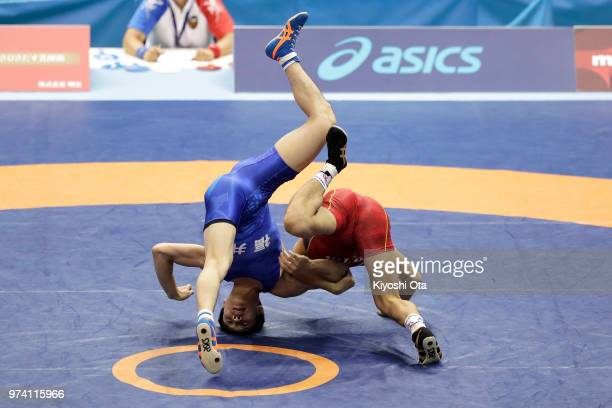 Kazuya Koyanagi competes against Raimu Maeda in the Men's Freestyle 61kg second round match on day one of the All Japan Wrestling Invitational...