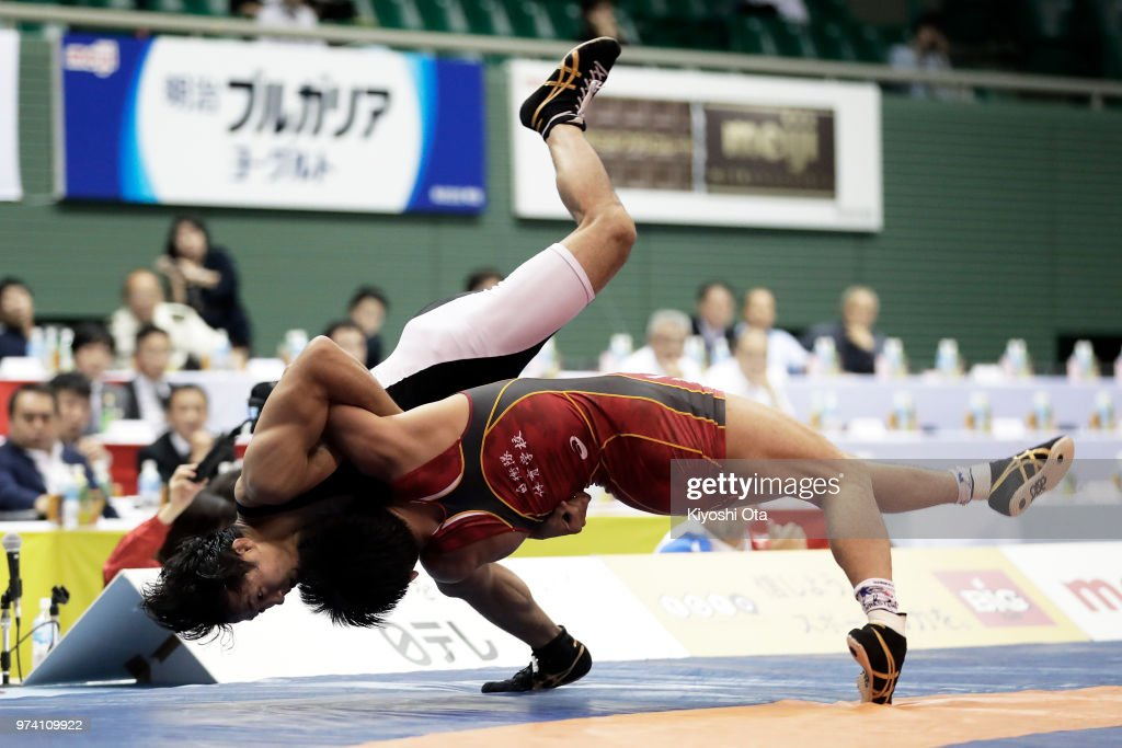 Kazuya Koyanagi (R) competes against Shingo Arimoto in the Men's Freestyle 61kg final on day one of the All Japan Wrestling Invitational Championships at Komazawa Gymnasium on June 14, 2018 in Tokyo, Japan.