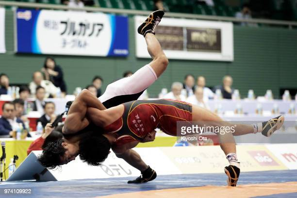 Kazuya Koyanagi competes against Shingo Arimoto in the Men's Freestyle 61kg final on day one of the All Japan Wrestling Invitational Championships at...