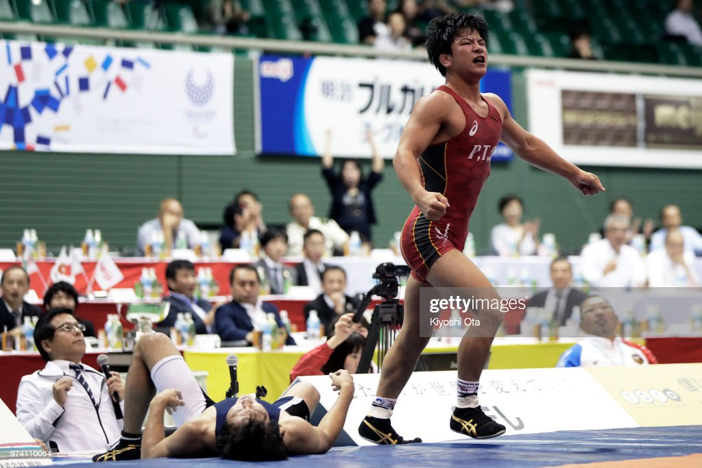 Kazuya Koyanagi (R) reacts after winning the Men's Freestyle 61kg final against Shingo Arimoto on day one of the All Japan Wrestling Invitational Championships at Komazawa Gymnasium on June 14, 2018 in Tokyo, Japan.