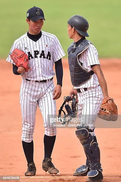 Kazuya Ojima of Japan talks with team mate Ryoya Kurihara during the Asian 18U Baseball Championship final game between Japan and South Korea at...