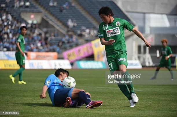 Kazuya Okamura of Kamatamare Sanuki challenges Shun Nogaito of FC Gifu but looks that he might use hand to stop the ball during the JLeague second...