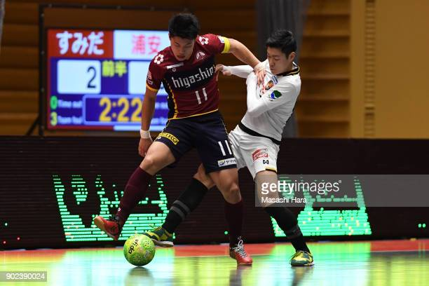 Kazuya Shimizu of Fugador Sumida and Kentaro Ishida of Bardral Urayasu compete for the ball during the FLeague match between Fugador Sumida and...