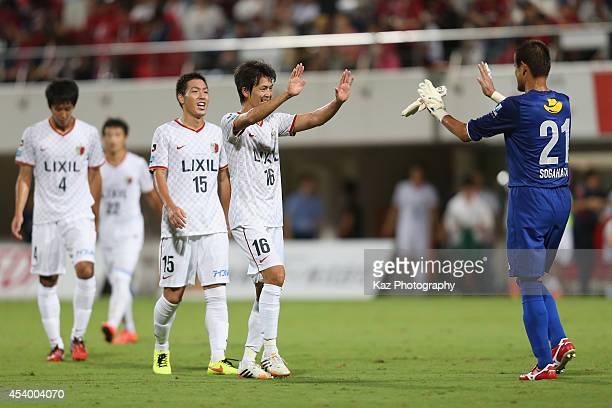 Kazuya Yamamura, Gen Shoji, Shuto Yamamoto and Hitoshi Sogahata of Kashima Antlers celebrate the 3-1 win in the J.League match between Shimizu...