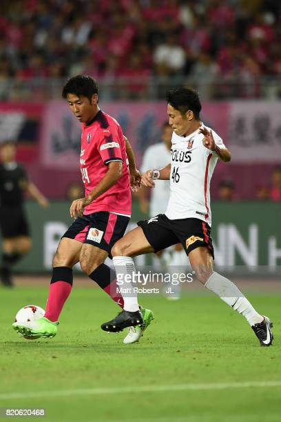 Kazuya Yamamura of Cerezo Osaka and Ryota Moriwaki of Urawa Red Diamonds compete for the ball during the JLeague J1 match between Cerezo Osaka and...