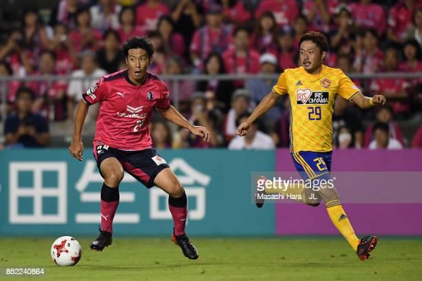 Kazuya Yamamura of Cerezo Osaka and Shota Kobayashi of Vegalta Sendai compete for the ball during the J.League J1 match between Cerezo Osaka and...