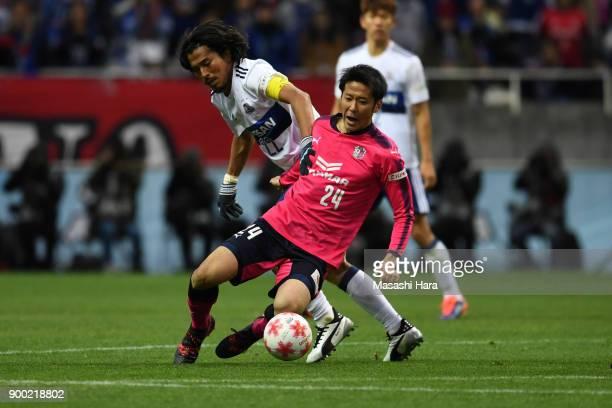 Kazuya Yamamura of Cerezo Osaka and Yuji Nakazawa of Yokohama Fmarinos compete for the ball during the 97th All Japan Football Championship final...