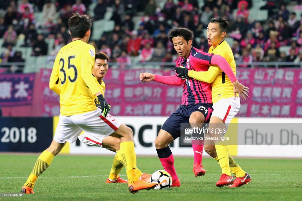 Kazuya Yamamura (2nd R) of Cerezo Osaka controls the ball against Gunazhou Evergrande defense during the AFC Champions League Group G match between Cerezo Osaka and Gunazhou Evergrande at the Yanmar Stadium Nagai on February 21, 2018 in Osaka, Japan.