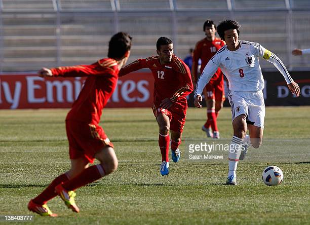 Kazuya Yamamura of Japan and Zakaria Al Omari of Syria compete for the ball during the London Olympic Men's Soccer Asian qualifier Group C match...