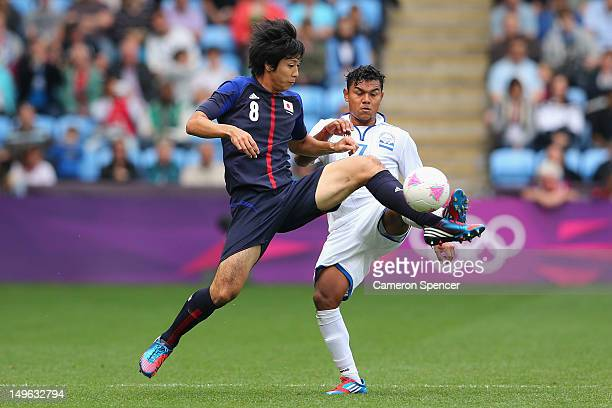 Kazuya Yamamura of Japan contests the ball with Mario Martinez of Honduras during the Men's Football first round Group D Match between Japan and...