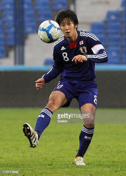 Kazuya Yamamura of Japan in action during the U-23 friendly match between Japan and Uzbekistan at Pakhtakor stadium on March 26, 2011 in Tashkent,...