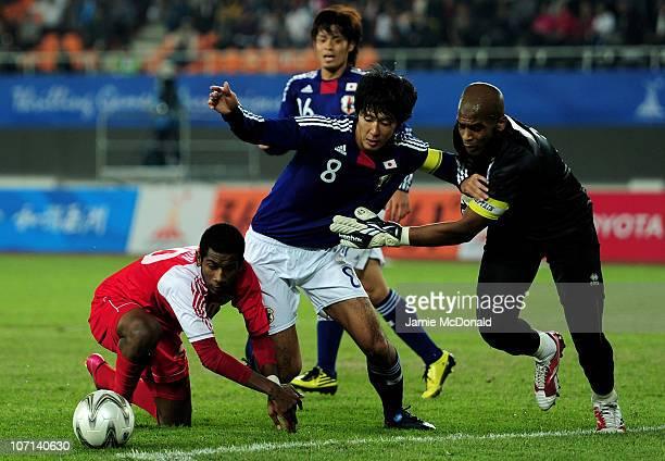Kazuya Yamamura of Japan is closed down by Theyab Awana Al Musabi and Goalkeeper Ali Khaseif Housani of United Arab Emirates in the Men's Final...