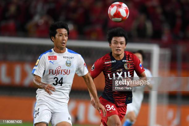 Kazuya Yamamura of Kawasaki Frontale and Ayase Ueda of Kashima Antlers compete for the ball during the J.League Levain Cup semi final second leg...