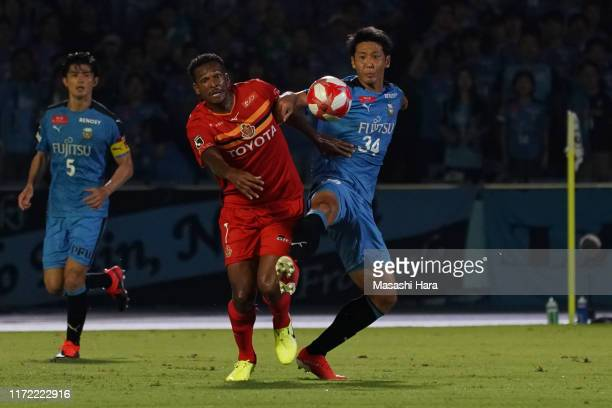Kazuya Yamamura of Kawasaki Frontale and Jo of Nagoya Grampus compete for the ball during the J.League Levain Cup quarter final first leg match...